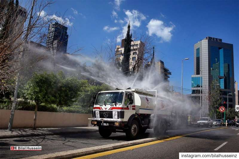 A municipal tanker sprays disinfectant as a precaution against the...